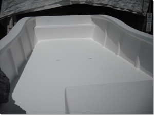 A shot of the boat after it just got sprayed with the gel coat.