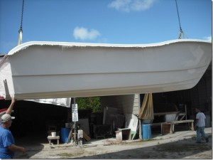 Here is the crane removing the hull from the mold.